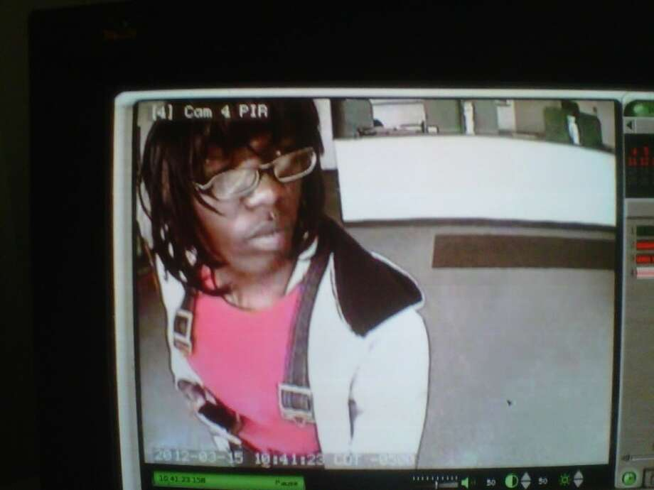 CrimeStoppers is offering a $5,000 reward for information leading to the arrest of this suspect and an accomplice in connection with the armed robbery of an EZ Money store. Photo: FT. BEND COUNTY SHERIFF'S OFFICE
