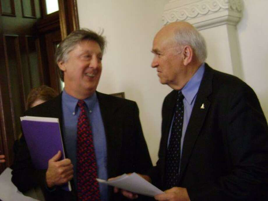 Randy Ashby, left, and Harv Hartman talk as they wait for the rest of the Clear Lake Chamber group to arrive for meeting with legislators at the state capital.