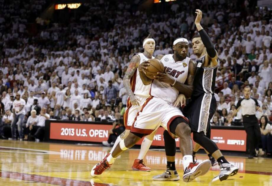 LeBron James, left, and the Miami Heat face Danny Green and the San Antonio Spurs in Game 3 of the NBA Finals tonight.