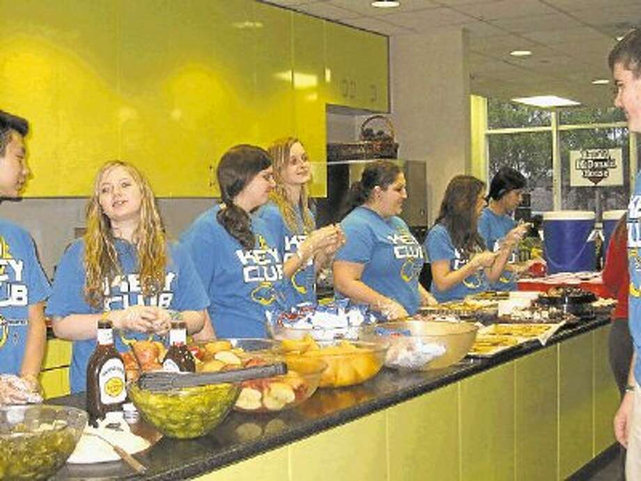 Members of the Cy Ranch Key Club, which is advised by the Kiwanis Club of Cy-Fair, serve food at the Ronald McDonald House at Houston's Medical Center. / @WireImgId=2565426