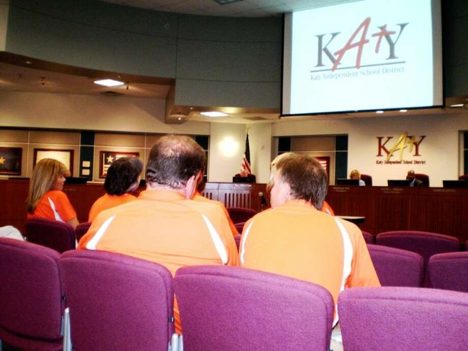 Members of the Seven Lakes High School Band Booster Club at the Katy ISD work study meeting June 10, showing their support for the construction of an additional 12,000-seat stadium for the district. Photo: Zach Haverkamp