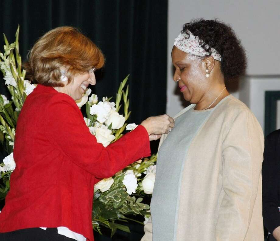 A student in the UH-D/LSC-K joint enrollment four-year teaching degree program is pinned by Dr. Myrna Cohen before receiving a certification recognizing her for being a part of the program and graduation at the Joint Admissions Celebration May 12.