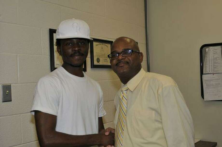 Timothy Omoniyi of Sugar Land (left) will soon participate in the Summer Undergraduate Research Experience at the University of Massachusetts Amherst. His Men of Honor mentor, Ralph Penn (right), wrote one of his recommendation letters for the program.