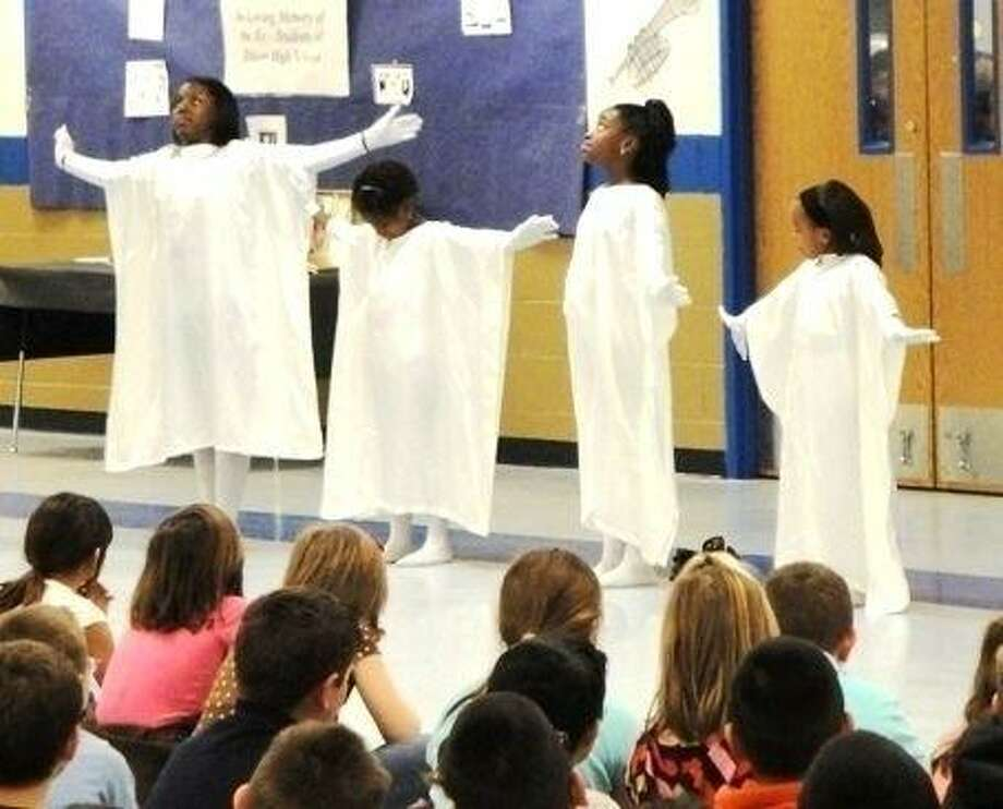 Members of the Lake Station Missionary Baptist Church Youth perform a Praise Dance during a Black History Month celebration Shepherd Intermediate School. The event was held on held on Friday, February 26, and hosted by Rev. Darryl Richardson. In addition to the Praise Dance, the program featured the reading of quotations, singing by by Kasi Wyatt and Ernest Pace, and a performance from the Shepherd High School Jazz band.