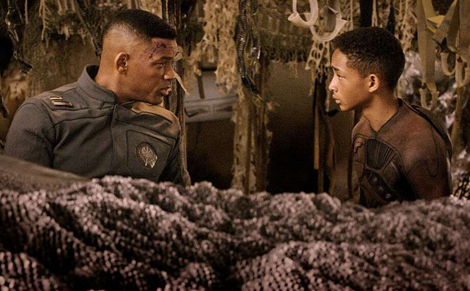 """Will Smith, left, and Jaden Smith star in Columbia Pictures' """"After Earth."""" Photo: Courtesy Of Columbia Pictures. / © 2013 Columbia Pictures Industries, Inc.  All Rights Reserved. **ALL IMAGES ARE PROPERTY OF SONY PICTURES ENTERTAINMENT INC. F"""