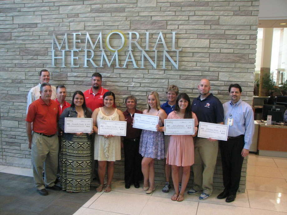 Five Katy ISD student trainers were awarded Sports Medicine scholarships by Memorial Hermann Katy Hospital. Pictured are (from left) Scott Barbe, Memorial Hermann Katy Hospital CEO; Charlie Stevens, Katy ISD Assistant Athletic Director; Russell Sadberry, Katy High School Athletic Trainer; Danielle Carlin; Justin Landers, Katy High School Athletic Trainer; Alyssa Carlin; Bennett Johnson, Cinco Ranch High School Athletic Trainer; Dakota Brower; Anjanette Butts, Taylor High School Athletic Trainer; Juliana Jimenez; David Worden, Seven Lakes High School Trainer; and Jim Parisi, Memorial Hermann Katy Hospital COO.  Whitney White is not pictured. Photo: Submitted Photo