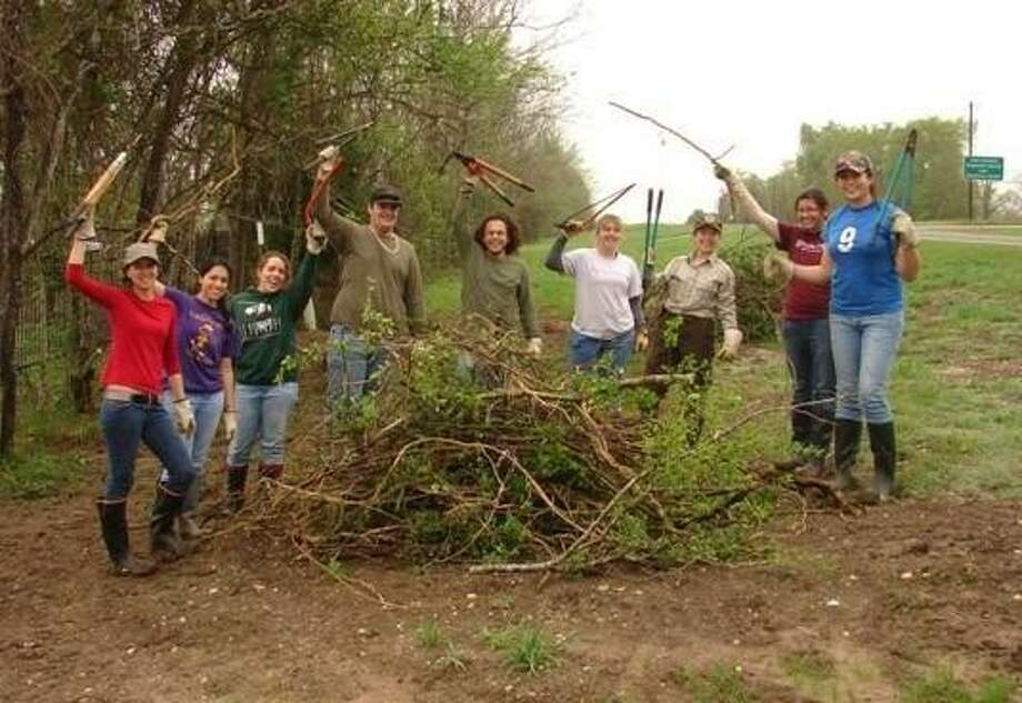 Texas A&M interns made improvements to the Trinity River Wildlife Refuge during spring break. Pictured are Shelby Vega, Ariana Gonzalez, Kristina Carter, Trey Hadley, Luis Martinez, Brittany Button, Laurie Lomas, Andrea Sanchez and Wei-Wei Lin. Photo: Submitted Photo
