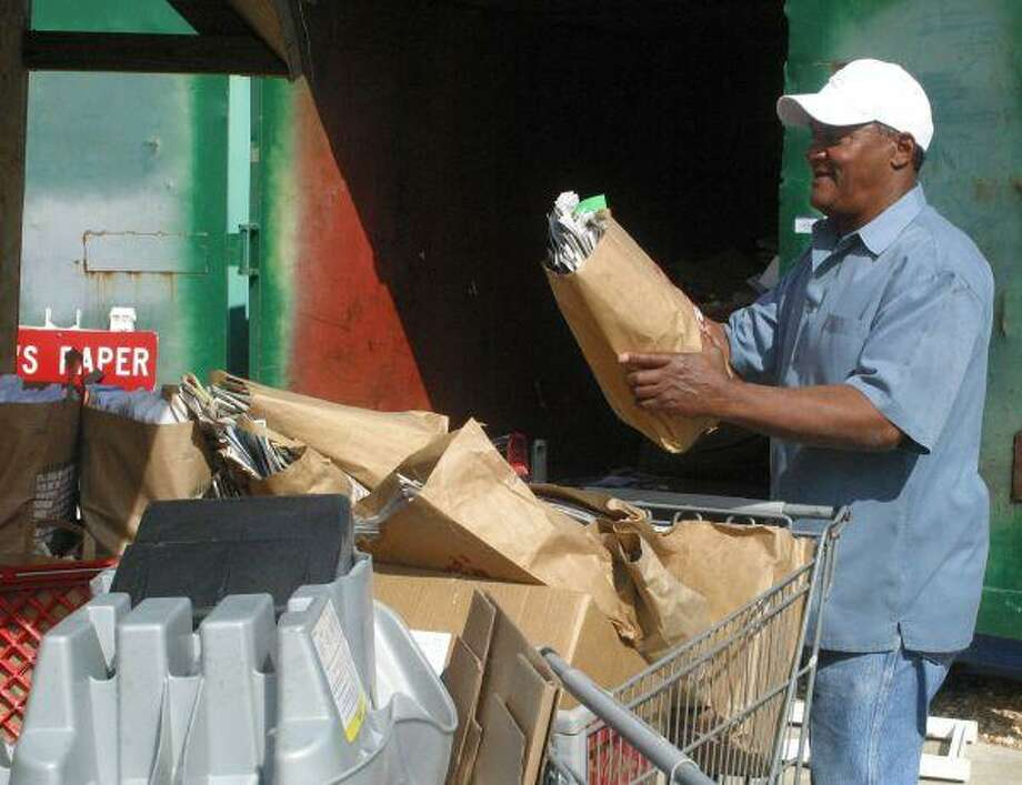 Johnson on the job at the Bellaire Recycling Center.