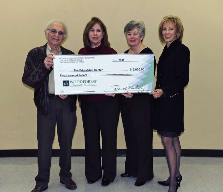 Pictured, left to right, are: Dr. David Gottlieb, Board of Directors, Woodforest Charitable Foundation; Anna Vidaurri, executive director of The Friendship Center; Susan Bond, director of operations, The Friendship Center; and Kim Marling, executive director and vice president of Woodforest Charitable Foundation. Photo: KIM MARLING
