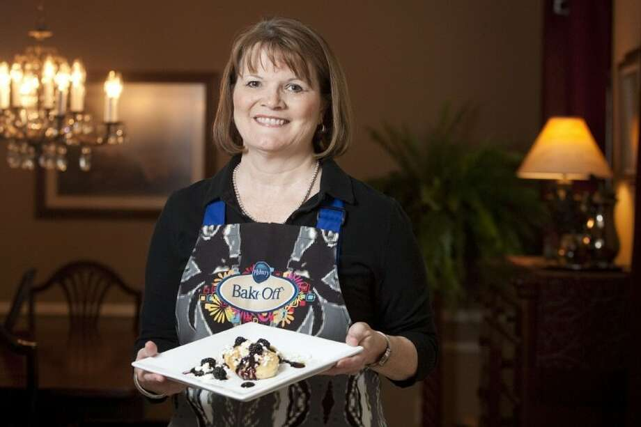 Jane Michel, a finalist in the Pillsbury Bake-Off, shows off her creation of biscuit corn cakes with goat cheese and blackberry-thyme sauce that placed her in the national competition. Photo: Karl Anderson