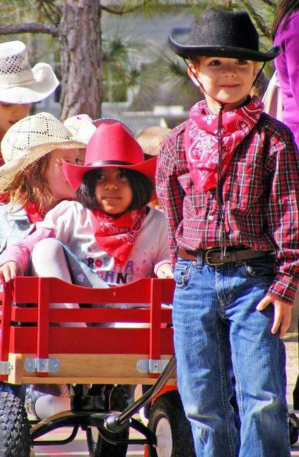 Galatas Elementary kindergartners wait for the bandana to fall, announcing the start of the wagon races during the school's Kindergarten Rodeo.