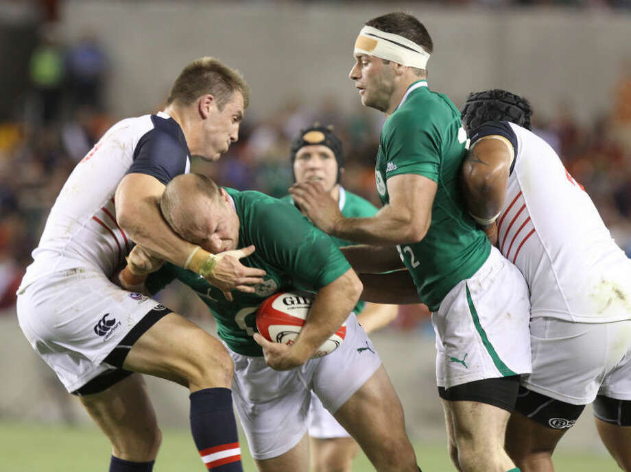 USA National Rugby Union's Chris Wyles puts hit on Ireland's Richard Strauss during their June 8 match at BBVA Compass Stadium in Houston.