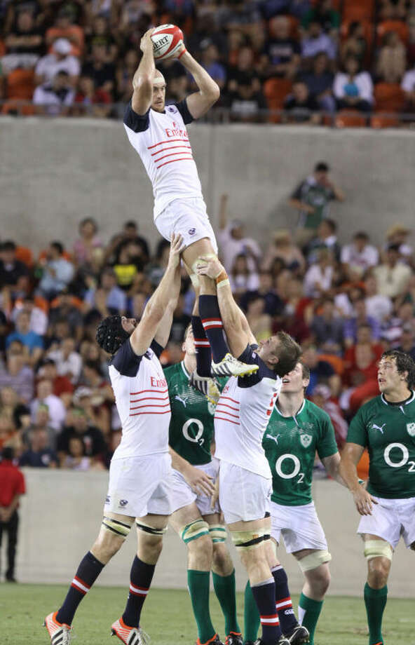 USA National Rugby Union's Scott Lavalla goes up high in a line-out against Ireland during their June 8 match at BBVA Compass Stadium. Photo: Alan Warren/HCN