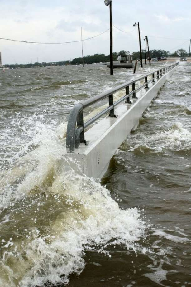 Waves start to wash over NASA Road 1 on Sept. 12, 2008, as Hurricane Ike approaches Galveston Bay. File photo