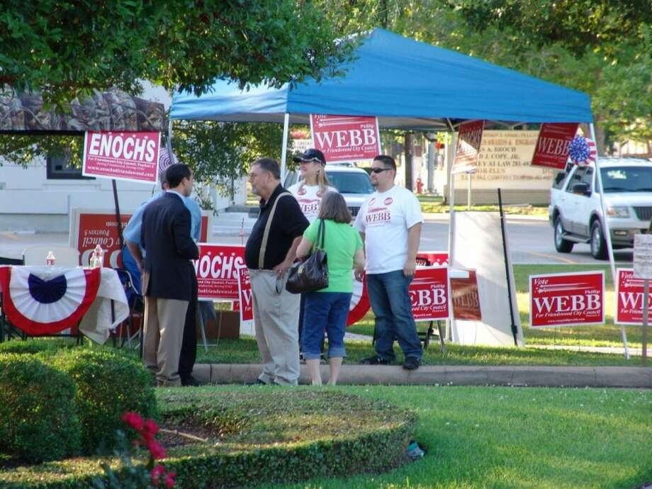 City Council Candidates Billy Enochs and Phillip Webb often campaiged together, including Election Day on the lawn at Friendswood City Hall.