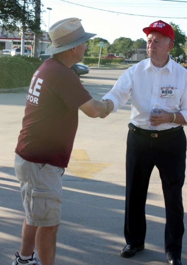 "Mayoral candidates Kevin Cole and Tom Reid shake hands at an east Pearland polling location Saturday (May 14). Later that evening, election results showed voters supported incumbent candidate Reid. The race was decided by margin of 693 votes with 2,346 or 58.6 percent in favor of Reid Saturday. Opponent Kevin Cole received 1,653 votes or 41.38 percent of the ballots. ""I had a good opponent. Kevin is a fine young man and ran an excellent race. It was one that I thought was well organized and well conducted,"" Reid said. ""But, it is apparent that the citizenry joined me in my vision of where we need to go as a community."""