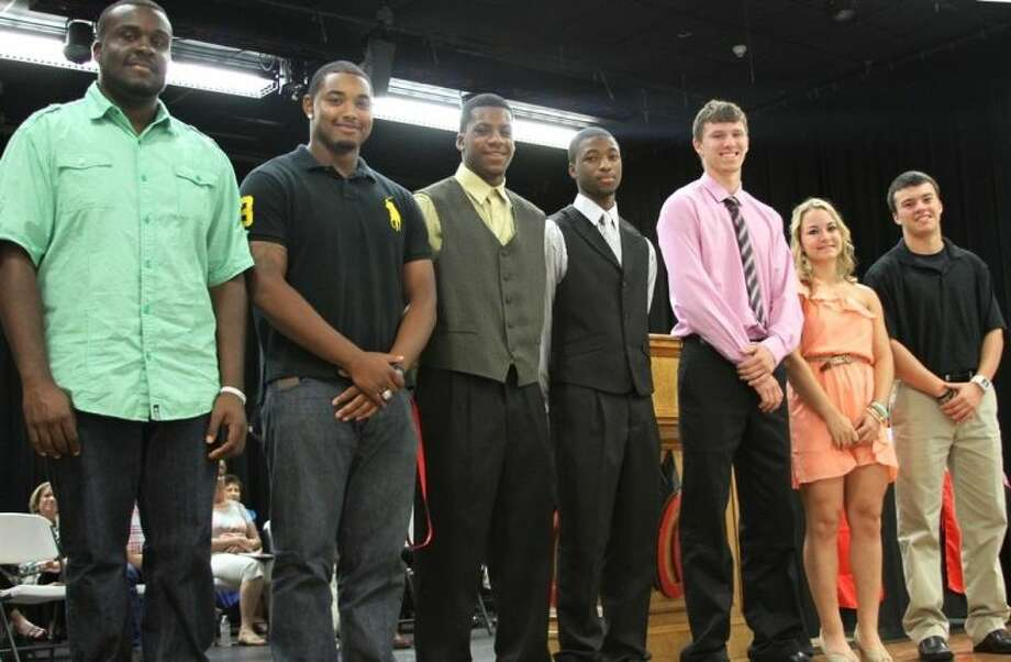 Athletic Collegiate Scholarship winners are (left to right) Nolan Walker, Jonathan Swint, Alfred Scott, Jerrell Sykes, Casey Lilley, Riley Browder and Bryce Shepherd.