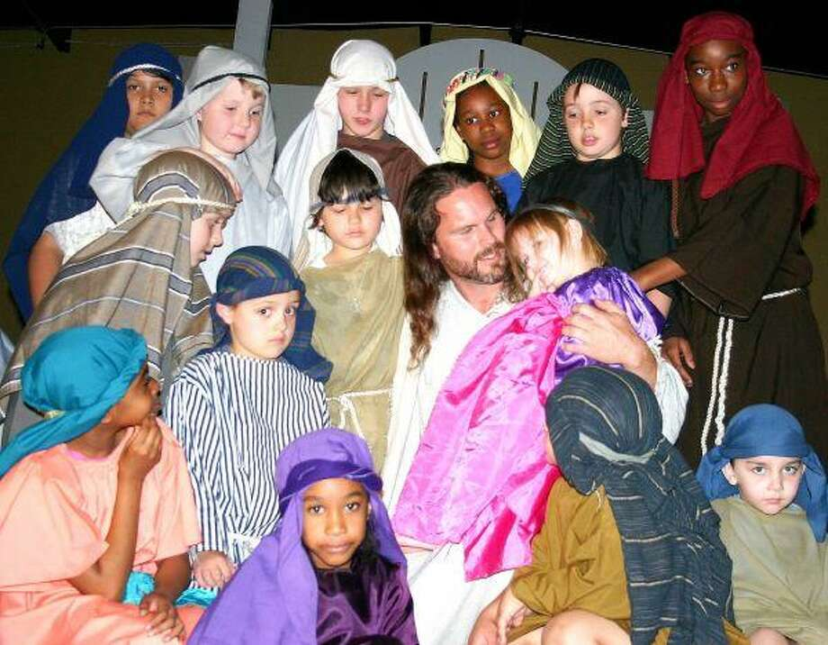 "Youth Pastor Lane Arnold (center) portrayed Jesus in the Family Faith Church's Passion Play ""Jesus: The Miracle."" The performance was produced at Family Faith Church's Coldspring campus on Thursday, March 31."