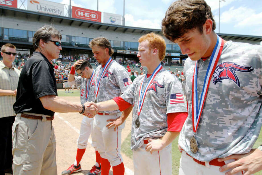 Fort Bend Dulles pitcher Caden Williams (4) shakes hands with Texas Governor Rick Perry after losing the Class 5A UIL state baseball championship game on Saturday, June 8, 2013, at Dell Diamond in Round Rock, Texas. The Woodlands defeated Fort Bend Dulles 9-5. Go to HCNPics.com to view and purchase this photo, and others like it. Photo: Staff Photo By Jason Fochtman