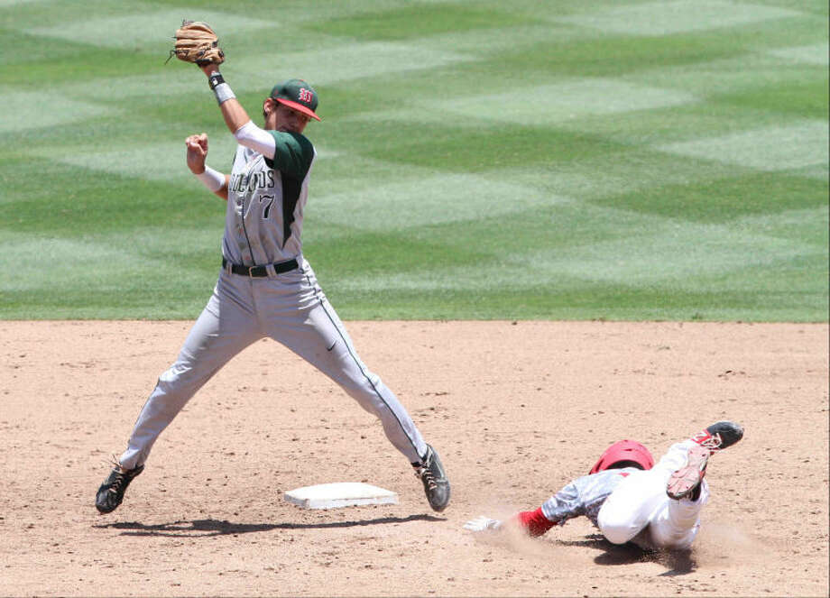 The Woodlands second baseman Luke Sherley (7) goes up for a catch at second during the Class 5A UIL state baseball championship game on Saturday, June 8, 2013, at Dell Diamond in Round Rock, Texas. The Woodlands defeated Fort Bend Dulles 9-5. Go to HCNPics.com to view and purchase this photo, and others like it.