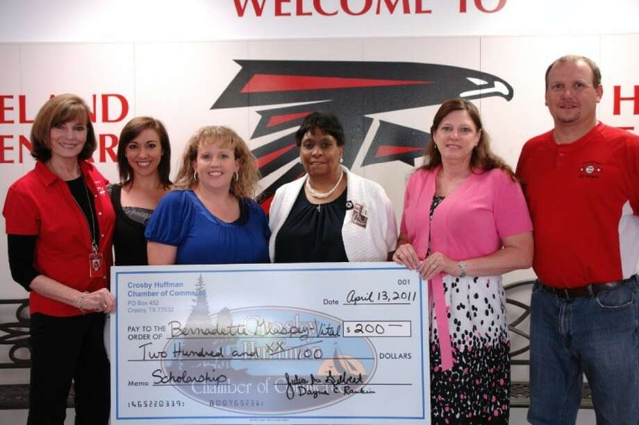 Bernadette Glaspy-Vital, art teacher at Copeland Elementary, was surprised by the visit where she was awarded a $200 scholarship for her classroom. Joining Glaspy-Vital, l-r, is Huffman ISD Interim Superintendent Jean Isaly, Ashley Courtney, Dayna Ranking of the Chamber, Glaspy-Vital, Chamber President Julie Gilbert, and Copeland Elementary Principal Jay Pratt.
