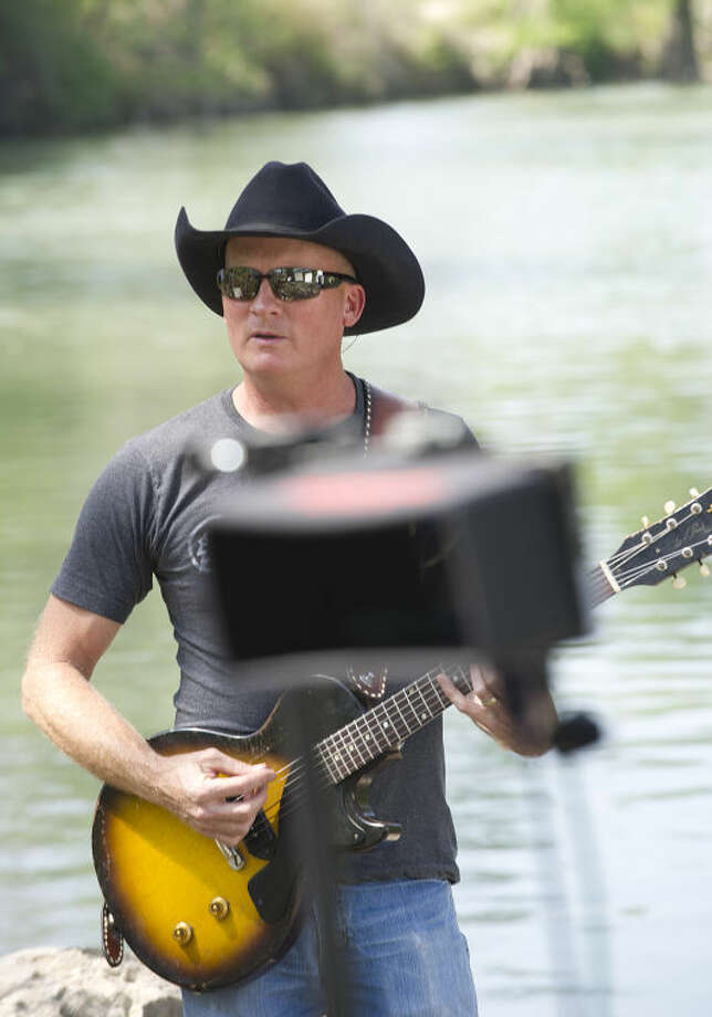 Kevin Fowler performs at Guadalupe River State Park. Photo: Chase A. Fountain, TPWD
