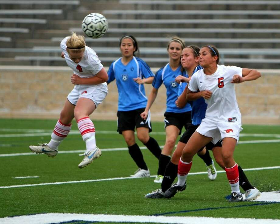 Memorial senior Cailey Cotner, shown here heading the ball, was named to the 19-5A All-District first team.
