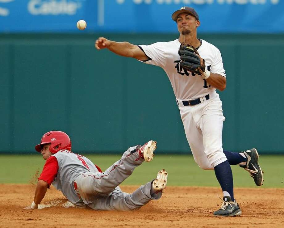 Rice's Ford Stainback, right, throws to first after getting the force on North Carolina State's Trea Turner in the seventh inning. N.C. State outlasted Rice in 17 innings, winning 5-4 to advance to the College World Series. Rice finished the season 44-20.