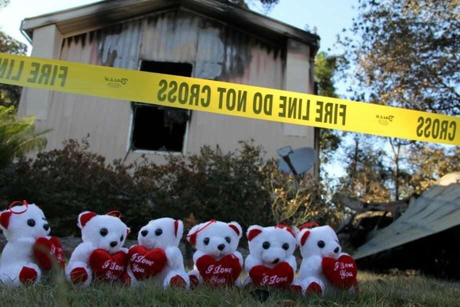 A tribute made of small teddy bears marks the site where four people, including three young children, died early Sunday morning in a mobile home fire. See Page 2A for the story on the continuing investigation.