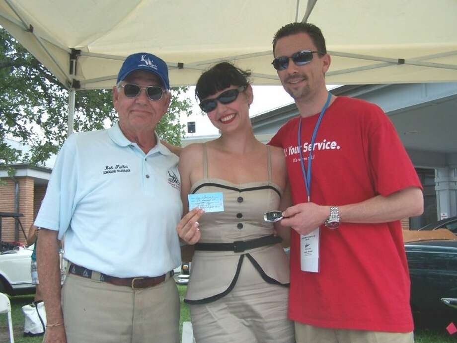 The 16th Annual Keels & Wheels held a raffle drawing on May 1 to win a 2011 Mercedes Benz C class sedan donated by Alex Rodriguez Mercedes-Benz dealership in League City. Winner of the prize Mercedes was Lakewood Yacht Club member Lou Marinos, who did not need to be present to win. Pictured are Keels & Wheels founder and chairman Bob Fuller, left, celebrity Heidi van Horne who drew the winning ticket, and Garrick Hatfield, general manager of Alex Rodriguez Mercedes-Benz dealership.