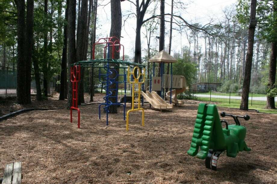 The trees surrounding the children's play area help provide a sense of privacy from the busy traffic of the North Eldridge and Malcolmson intersection.