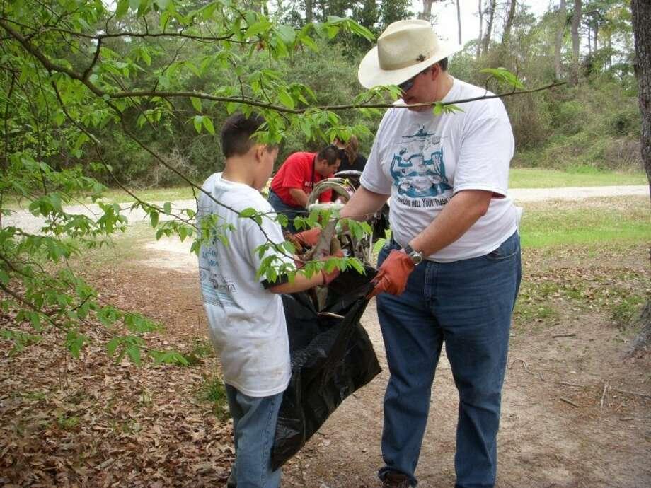 Volunteers collect trash at Collins Park at the 2010 Trash Bash.