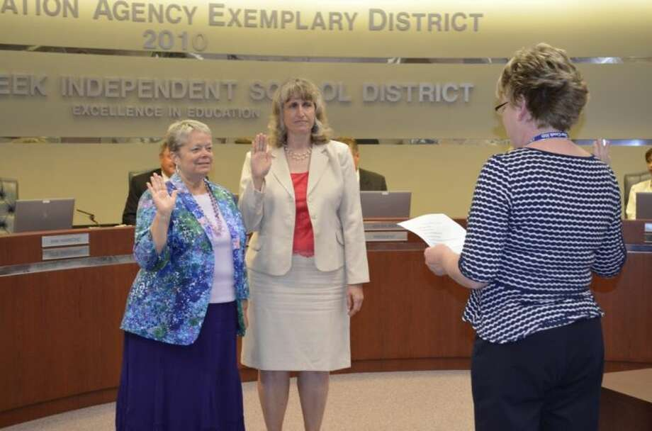 From left, CCISD Board of Trustrees President Ann Hammond and Trustee Laura DuPont are sworn in by Executive Assistant Jolene Engel. Photo: Courtesy Clear Creek ISD