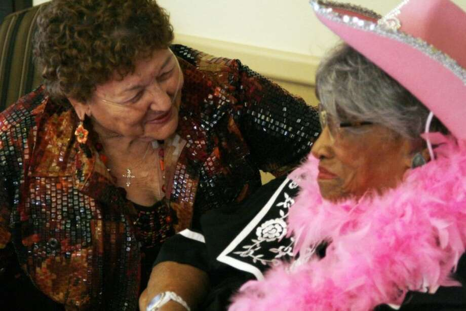 Ethel Huntley, right, talks with a friend at Regent Care Center of Kingwood at her 101 birthday party March 21.