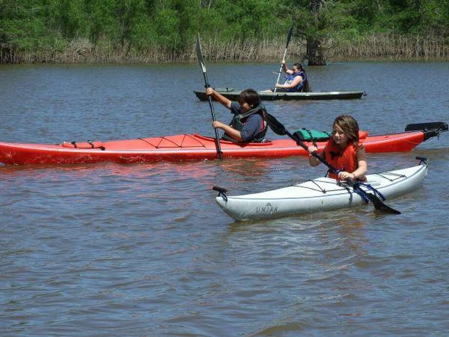 Dozens of youth and adults spent the afternoon having a great time kayaking and fishing at the Trinity River National Wildlife Refuge in commemoration of the 40th anniversary of Earth Day on Saturday, April 24th.