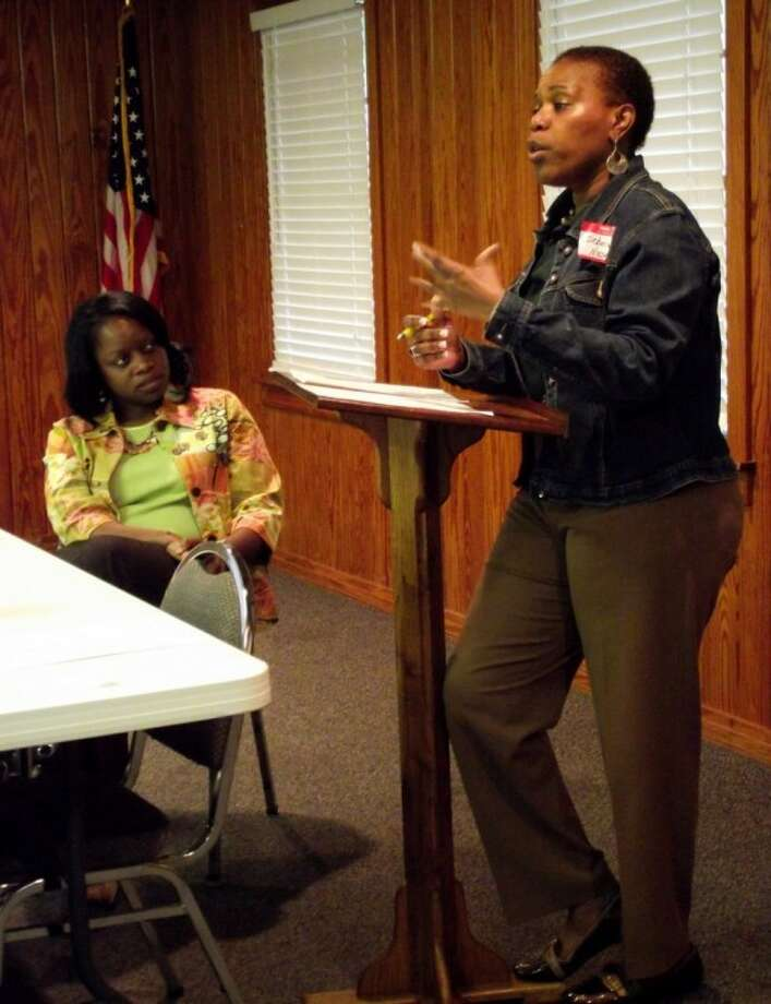 Nixon Adult Day Center owner Debora Nixon was the guest speaker at Tuesday's luncheon. COCISD Superintendent Dr. LaTonya Goffney, seated left, listens as Nixon discusses the advantages of adult day care over nursing home care. The Coldspring/San Jacinto County Chamber of Commerce held its monthly luncheon at the Coldspring Community Center on Tuesday, March 20. Photo: CASSIE GREGORY