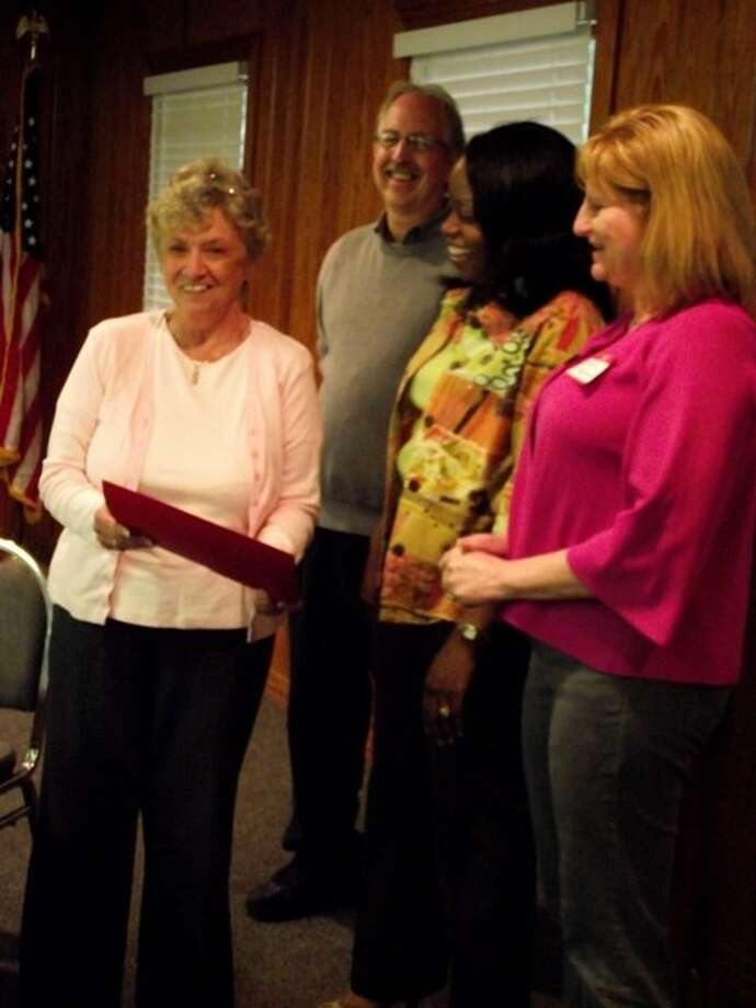 In gratitude for the PowerPoint presentation she created for the Best of San Jacinto County Awards Banquet, Connie Straus, shown left, was presented with an honorary certificate Tuesday by Chamber President Paul Shelton, Vice-President Dr. LaTonya Goffney and Board Member Sandra McQuiggin. The Coldspring/San Jacinto County Chamber of Commerce held its monthly luncheon at the Coldspring Community Center on Tuesday, March 20. Photo: CASSIE GREGORY