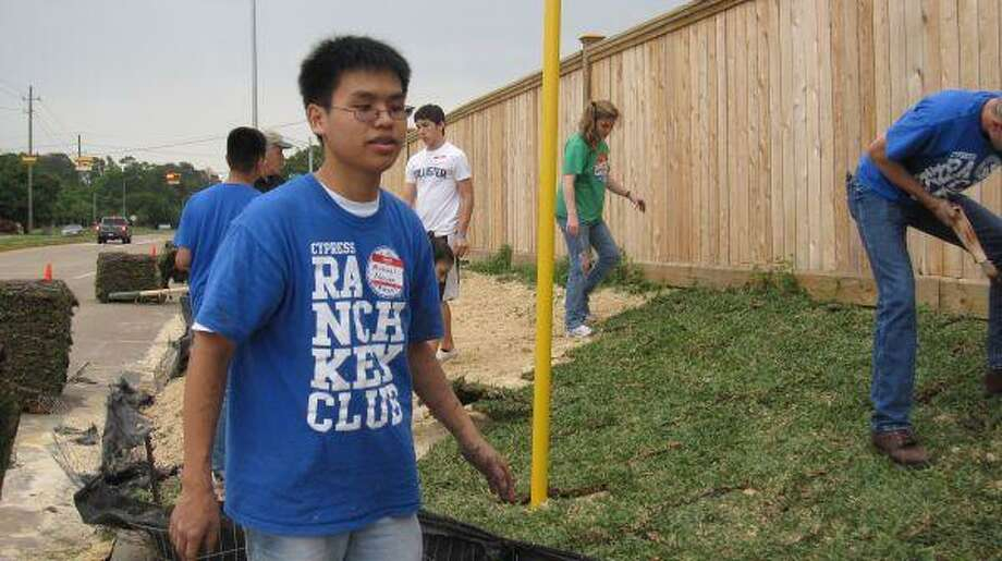 Cypress Ranch sophomore Michael Nguyen and fellow Key Club students lay sod at a house being built by Habitat for Humanity Northwest Harris County on April 10.