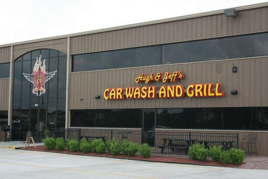 Once you come upon this sign for Hugh & Jeff's Car Wash and Grill off Highway 646 feel free to stop in and get your car or truck washed and have a drink while you're at it.