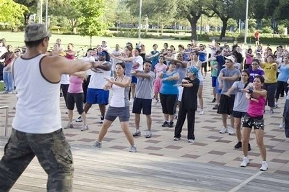 Everybody Zumba! One of the many classes offered at Discovery Green.