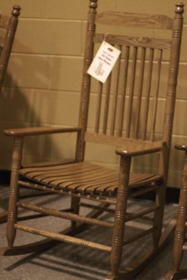 Retirees received rocking chairs from Liberty ISD. Photo: CASEY STINNETT