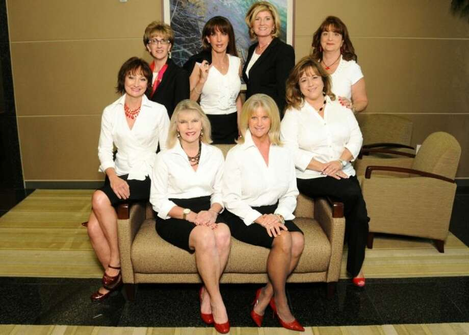 The Women Driving Business Committee. Seated in front (from left): Connie Inman and Jeannie Bollinger. Top row (from left): Constance McDerby, Dulcie Wink, Sarah Cain, Kathie Edwards, Lisa Morton and Tere Batista. Photo: Eric Kleiman