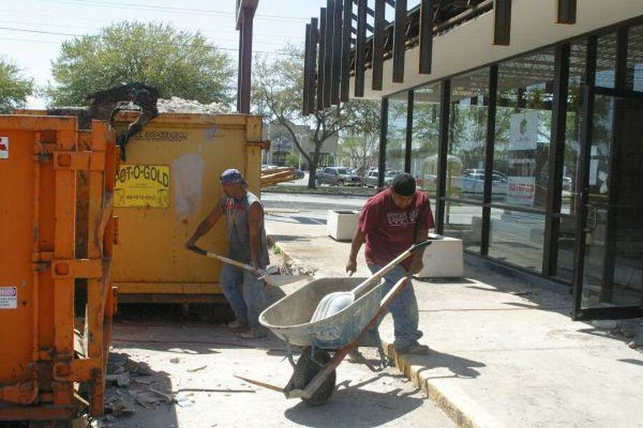 Workers remodel the old Dunkin Donuts for a new owner.