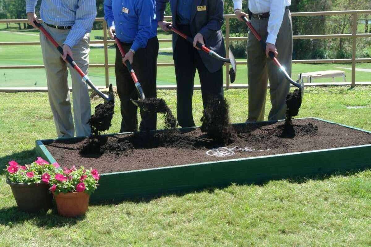 Kingwood Country Club officials ceremonially turn dirt for the renovation of the clubhouse.