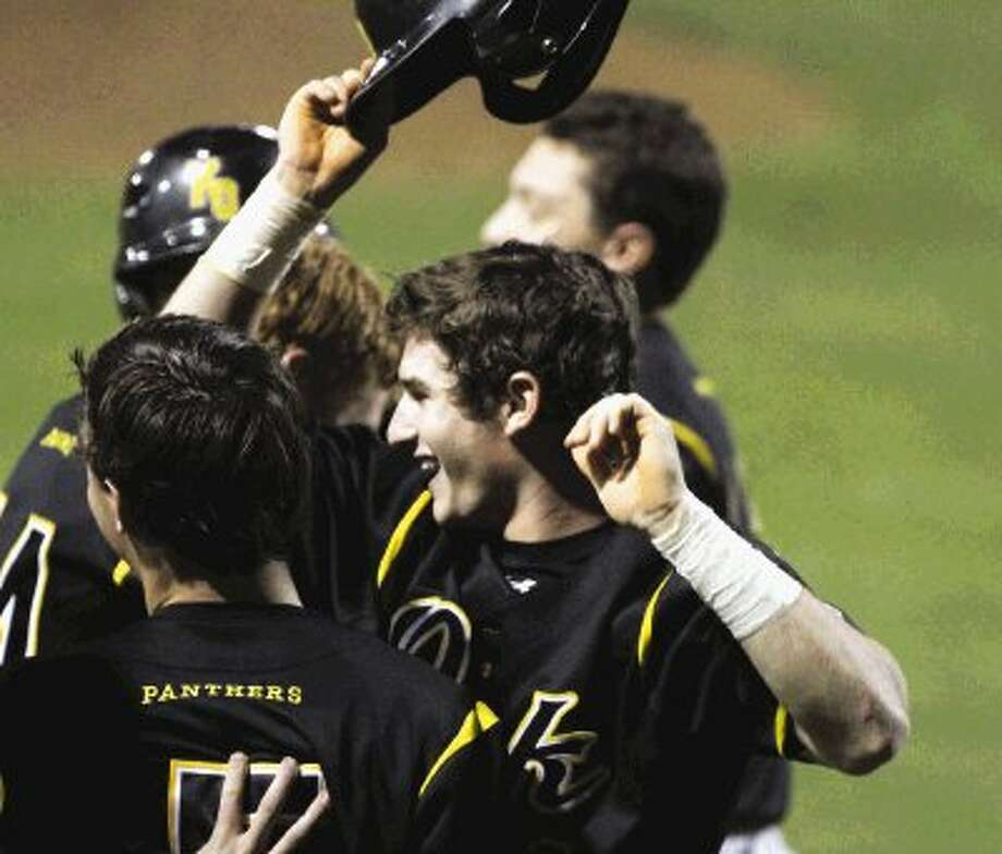 Klein Oak's Dustin Theiss (4) celebrates after scoring the winning run off a wild pitch in the bottom of the seventh inning Thursday night against Spring at Klein Oak High School. Klein Oak defeated Spring 5-4. Photo: Jason Fochtman