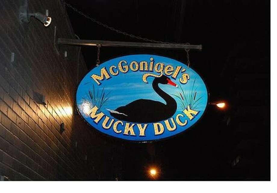 The Mucky Duck, at 2425 Norfolk, is known for hosting singer-songwriters, including some Texas favorites. Early Monday morning, it was site of a botched theft job after suspects were scared off by a neighbor.
