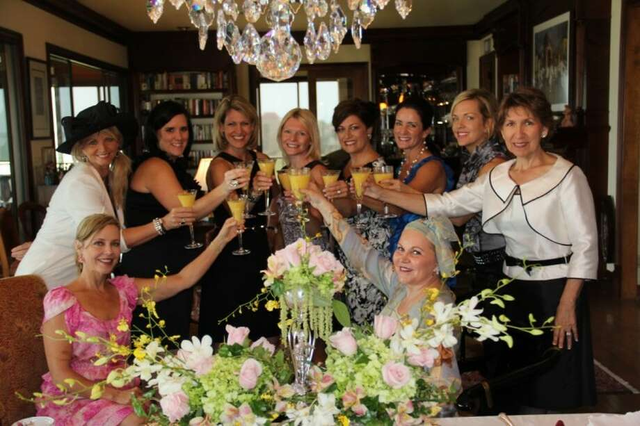 Bay Area Houston Ballet & Theatre Scholarship and Endowment Council toast another great year at this year's Spring Scholarship Tea. They are, from left, standing, Jill Reason, Jennifer Ball, Lisa Roberts, Debbie Ellis, Carrie Philson, Lisa Barnard, Terri Dodd, Judy Harper; seated, Sandy McKinney and Lynette Mason Gregg.