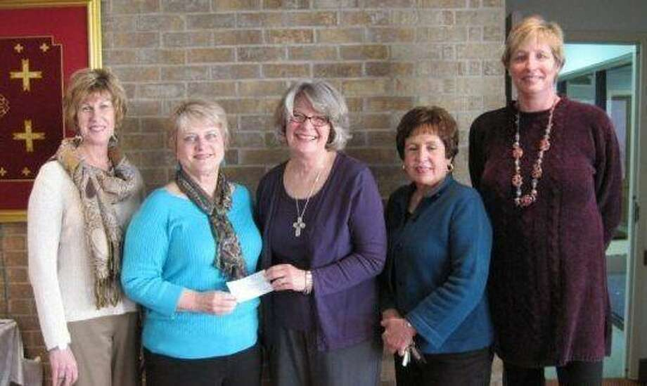 Kingwood Women's Club makes a donation to Feed My Lambs. Judy Tefteller, center, accepts the check from KWC members, from left, Mary Hubbard, Judy Thigpen, Julie Pappas and Bettie Browning.