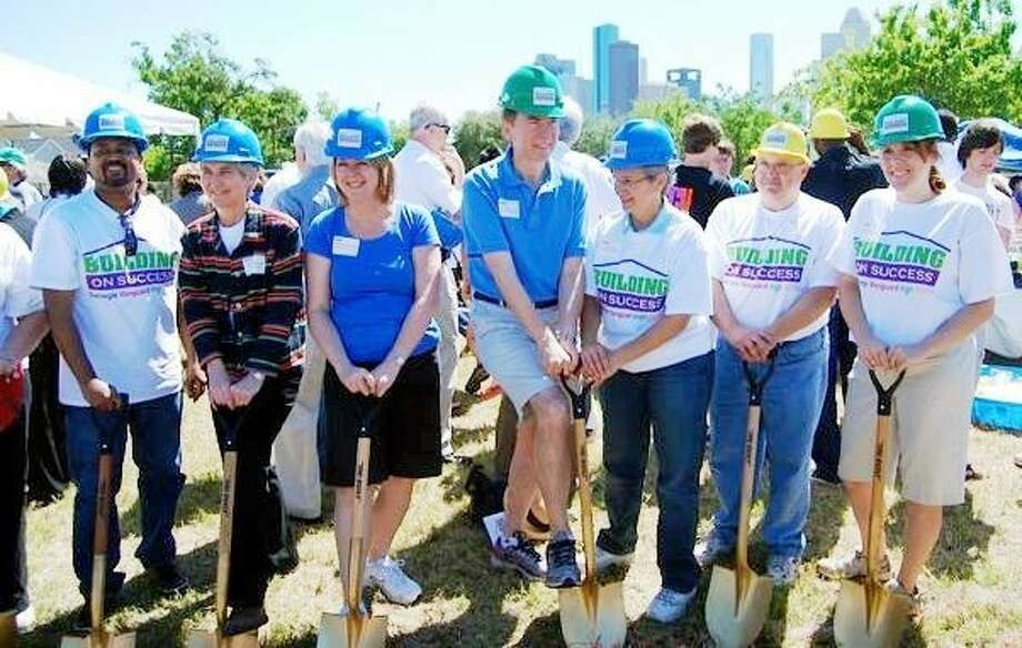 Parents and school staff took their turn following the dignitaries to turn a shovel of dirt.