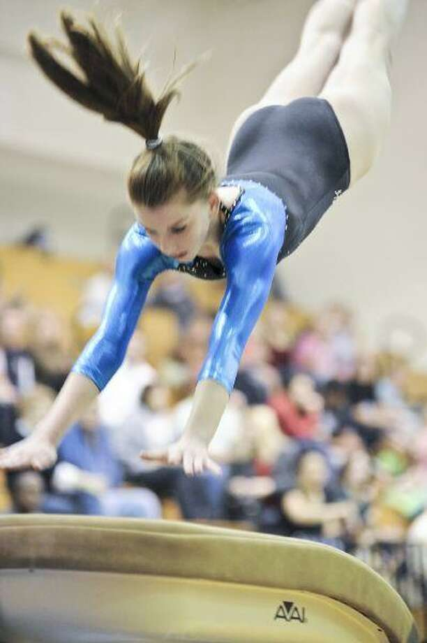 Freshman Katie Allison competes at the District Gymnastics Championship last Friday. The competition was held at Atascocita High School. / © by Jose Quiroz 2009